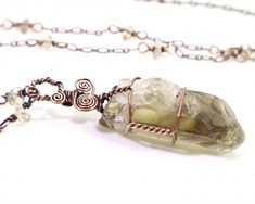 This is genuine unheated smoky citrine from Russia, which I have wire wrapped on a hypoallergenic copper chain. #citrine #citrinependant #citrinenecklace #citrinejewelry #unheatedcitrine #unheatedcitrinependant #untreatedcitrine #untreatedcitrinependant #rawcitrine #rawcitrinependant #roughcitrine #smokycitrine #genuinecitrine #naturalcitrine #solarplexuschakra #crystaljewelry #crystalhealing #rawcrystals #rawcrystaljewelry #gemstonejewelry Raw Gemstone Jewelry, Healing Crystal Jewelry, Gems Jewelry, Boho Jewelry, Pendant Jewelry, Unique Jewelry, Citrine Pendant, Raw Gemstones, Wire Wrapped Jewelry