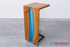 How to build a waterfall epoxy resin river table from a live edge slab. I'll show you how to pour thick epoxy resin pours, how to cut a waterfall joint, and how to finish it all. Full video tutorial included!