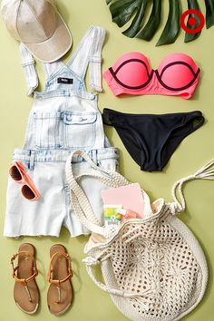 Now that summer's in full swing, it's time to hit the beach. Start with a bandeau bikini top and solid black bottoms (because nothing is easier), then top it off with a pair of denim shorteralls, a baseball hat, sunglasses, sandals, and a woven bag.