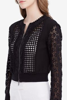 Modern and romantic, the DVF Jesica is a new bomber jacket in a mix of stretch jersey and our flower lace that brings just enough allure to everything from summer cocktail dresses to jeans. This lace is easy to care for and does not wrinkle, making it ideal for travel. With front full zip. Fit is true to size.