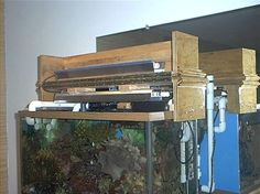 Link for DIY canopy with flip open? - Reef Central Online Community & aquarium canopy - Google Search | Reef Tank Canopy Ideas ...