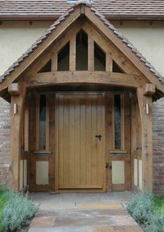 Border Oak porch - ideal space for dirty wellies! Oak Framed Buildings, Timber Buildings, House With Porch, House Front, Porch Doors, Porch Entrance, Building A Porch, Building A House, Front Porch Design