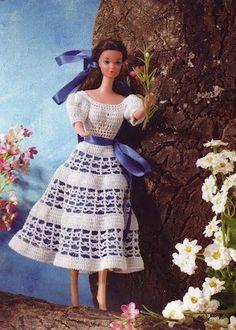 Robes Barbies , accompagnées de leurs grilles gratuites et explications en Français , trouvées dans la Galerie Picasa de & Choumi & . Robe orné de ruban bleu Joli robe froufrou Robe rose et blanche Robe rouge Robe verte et blanche Je souhaite un agréable...