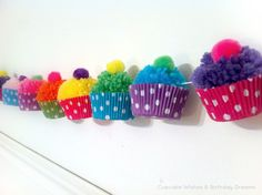"DIY Yarn Pom-Pom Cupcake Garland - How cute is this!  What a great decoration for any party! -+""~_"