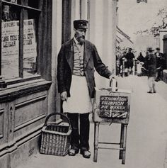 Champion Pie Man - W.Thompson, Pie Maker of fifty years, outside his shop in the alley behind Greenwich Church