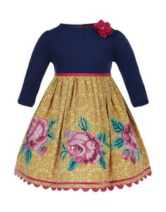 Our Clarabella dress will take your baby girl from playdate to party. Made from pure cotton, this lace print dress features embroidered roses, a fixed corsage and ric-rac trim. Fully lined.