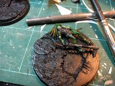 Time for Basing! after desciding on an urban theme i CAD designed and 3D printed my custom base, then used some PVA, super glue and tissues to almost paper mache the surfaces that print with ridges to smooth them out. this works fairly well and gives and interesting texture. Also I ditched the idea of BOB standing on a rock. Hes standing on a Kroot! why? because why not! :D I had to repose this guy to look natural and am happy with how he turned out.
