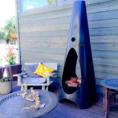 """Wood-burning """"ModFire"""" in steel to heat the patio in ultra modern fashionable blue. 140#'s."""