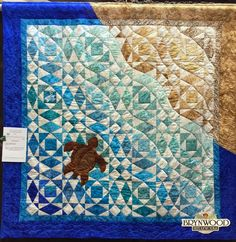 """""""Poipu Beach"""" by Madeline Schminke. 2015 Peace River Quilt Show. Photo by Brynwood Needleworks.  @ http://brynwoodneedleworks.blogspot.com/2015/02/peace-river-quilt-show-weekend.html"""