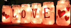 """""""Love Lanterns"""" from old jars. Mod Podge pink tissue paper, add cutouts from red paper, hot glue ribbon at top and insert string lights! Adorable!!"""