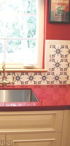Handcrafted, one of a kind ceramic tiles on kitchen back splash. All of our tiles are painted by hand. #tiles #handpaintedtiles #kitchenbacksplash