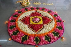 simple and traditional styled Rangoli created with flower petals.