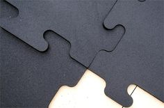 Interlocking Rubber Puzzle Mats made from recycled car and truck tires.