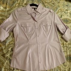 NWOT Victoria's Secret Work Shirt - Lavender Classic fitted long sleeve shirt from Victoria's Secret, color is Lavender.  Size Medium. Never worn, brand new!  Special bundle sale buy two items and get 25% off. Several other styles available in my closet.   No trades, no holds, no PayPal. Victoria's Secret Tops Button Down Shirts