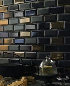 Beveled subway tile in dark & metallic glaze.  Fabulous!