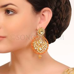 EAR/1/3445	 Earrings in dull gold finish studded with kundan and red coral 	$128	£76