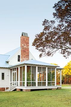 The screened porch was built to look as if it had been added on at a later time.