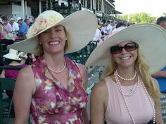 These are two clients wearing Polly Singer hats who met at the Kentucky Derby after noticing that I designed both of their hats.  Hats do bring people together!