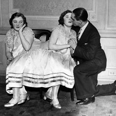 Margaret Gibbs gets a kiss from her fiance while her conjoined twin sister Mary looks on, 1930s.  Margaret's fiancé would only marry her if the women were separated, which they decided against as they were told they would probably be unable to walk afterwards. They both remained single until their deaths at age 55.