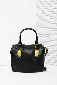 This black vegan leather satchel is perfect for work, going out, or that hot date you have this weekend.