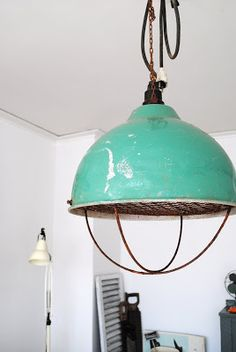 Another thing that keeps catching my avian eyes lately are all the stunning vintage industrial pendant lights to be spotted. image courtesy ...