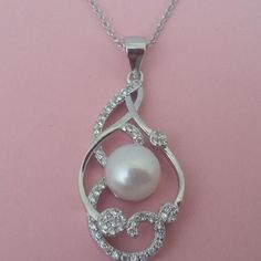 Colgante de plata con perla cultivada