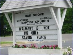 A church sign making a reference to Walmart's low prices.