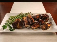 """Moroccan spiced short ribs from """"The New Passover Menu"""" by Paula Shoyer are flavored with cumin, turmeric, thyme, cinnamon and barbecue sauce."""