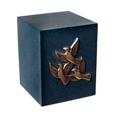 I don't think I have ever seen an urn that was square before. It is a nice looking urn that would be appropriate for a lot of people. I like the doves on the side to symbolize peace. I think this is what my grandmother would like for her urn. She likes doves and the color is very nice as well.