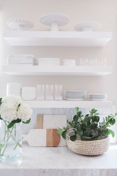 white kitchen + marble + floating shelving