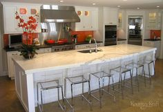 Gorgeous island offers seating for six. The orange backsplash gives a real punch of color to this hip kitchen in Darien, CT. Designed by True North Cabinets. Modern Kitchen Cabinets, Kitchen Layout, Kitchen Countertops, Kitchen Design, Kitchen Ideas, Custom Kitchens, Cool Kitchens, Inset Cabinets, Custom Cabinetry