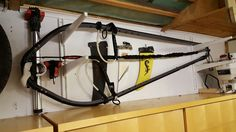Great way to store your windsurfing equipment in your garage with this storage rack