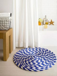 Fashion a rope rug to add personality in your bathroom! Click through for more looks: http://www.bhg.com/bathroom/remodeling/projects/easy-diy-bathroom-projects/?socsrc=bhgpin091114fashionaroperug&page=4