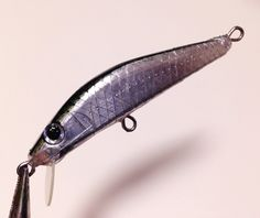 Fishing lure I made from hinoki wood and polymer clay.