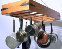 Hanging Pot Rack - store pots, pans, utensils and cookware from this ceiling mounted rack supplied with 10 hooks for convenient storage.