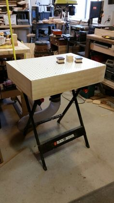 Downdraft sanding table on A workmate base.                                                                                                                                                                                 More