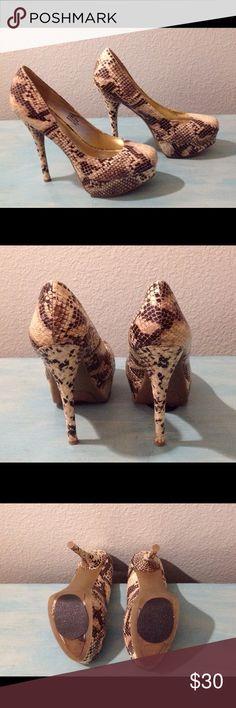 "Sigi Soho ""Staple"" Snake Print Platform Pumps Beautiful and sexy snake print platform pumps. Fabric upper, man made sole. 5"" heel, 1.5"" platform. Only worn a couple of times and in great condition. Sigi Soho Shoes Platforms"
