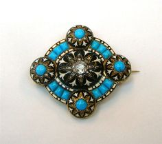 Victorian brooch circa 1850. Diamond center stone and cabochon turquoise accents for added romantic brilliance