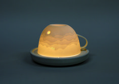 Ceramic cup with LED saucer by Jin-Woon Koo. varying thickness creates a moonlit landscape.
