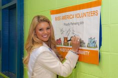 Miss South Carolina Ali Rogers signs a Habitat for Humanity sign during a day of service with #HabitatNYC  Learn more about Habitat NYC at Habitatnyc.org