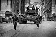 """1974 Carnation Revolution - Portuguese Army soldiers and tanks of the left-wing revolutionary Armed Forces Movement (Movimento das Forças Armadas) mobilize on the streets of Lisbon in a coup d'etat against the Fascist """"Estado Novo"""" regime."""