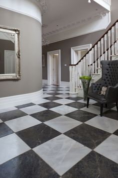 Di Scacchi Tumbled Marble. The perfect traditional black and white floor; the Tumbled, worn finish gives the impression it has been walked on for centuries. www.mandarinstone.com #chequerboard #opulent #marble