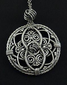 "Pendant | Iza Malczyk.  ""Love Knot"".  Oxidized sterling and fine silver wire."