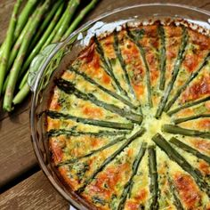 Perfect for brunch: Crustless Asparagus Quiche! Made with farm fresh asparagus, spinach, mushrooms, and three cheeses!
