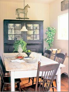 black cupboards and antique white painted wood pannel walls-kitchen