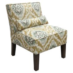Ikat-upholstered slipper chair with exposed legs. Handmade in the USA.    Product: ChairConstruction Material: So...