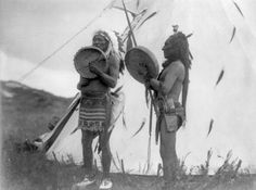 Dakota Indian Art | Photograph:Two Dakota Sioux sing and play hand drums consisting of a ...