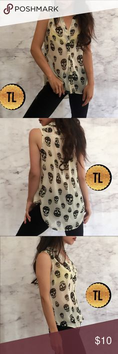 """White sheet button down tank black skulls print •NWOT  •ships tomorrow •unbranded / boutique brand •no trades  •true to size     Model: goguios in insta  (account manager) modeling  Please visit """"Closet Rules"""" for more info about us :) boutique Tops Tank Tops"""