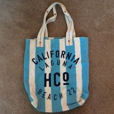 Hollister Beach Bag Used but in great condition. Blue and white striped with navy stitching. Small spots near the bottom as pictures but should come out in the wash. If purchased I will wash one more time before shipping. Hollister Bags Shoulder Bags