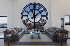 The tower has four 14-foot-tall glass clock faces that surround the living space.